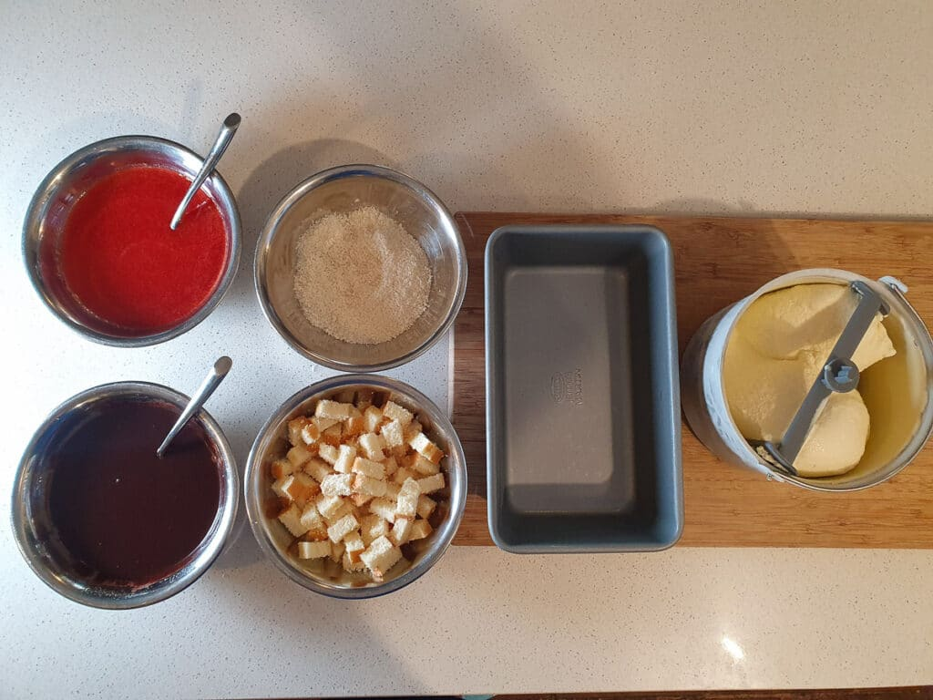 Mix ins, storage pan and sponge cake ice cream ready to layer ice cream and mix ins.