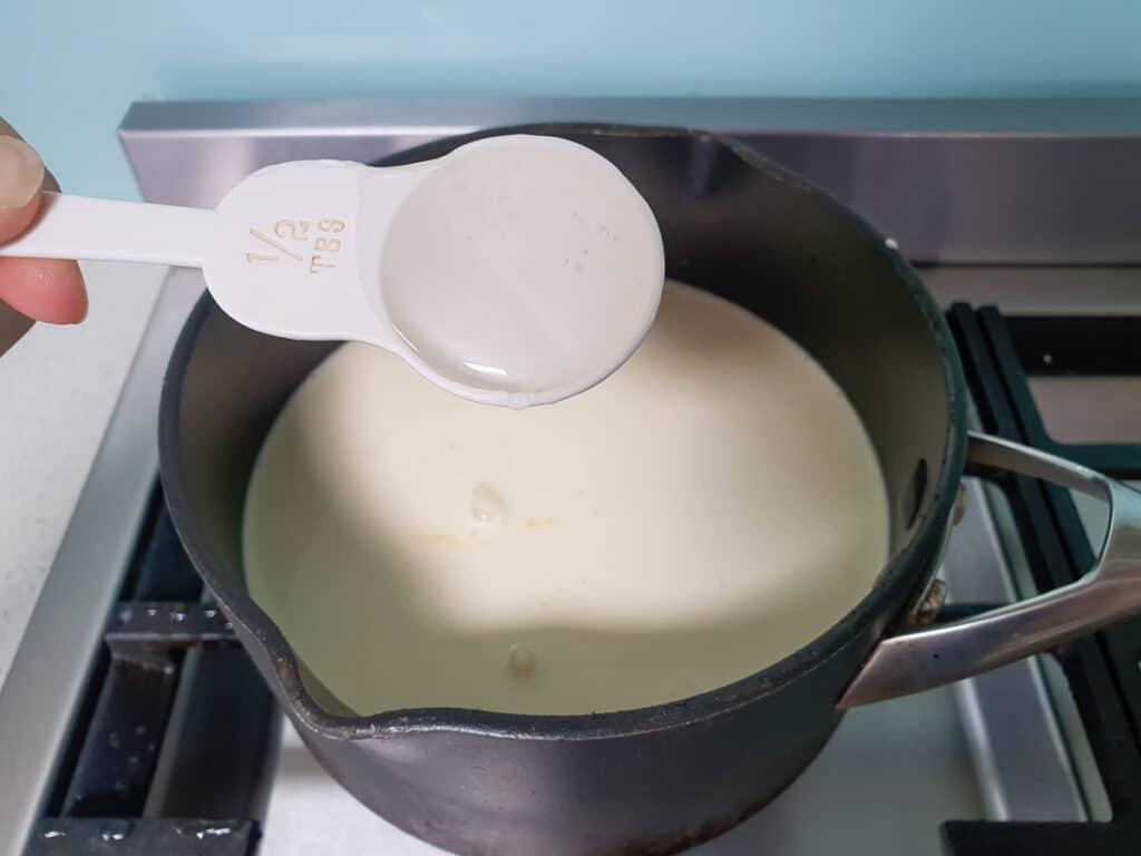 Adding glucose syrup to ice cream mix.