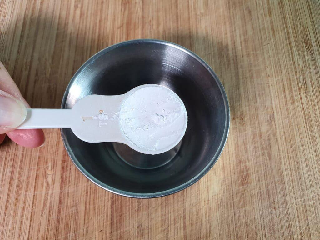 Adding tapioca starch to a small bowl.