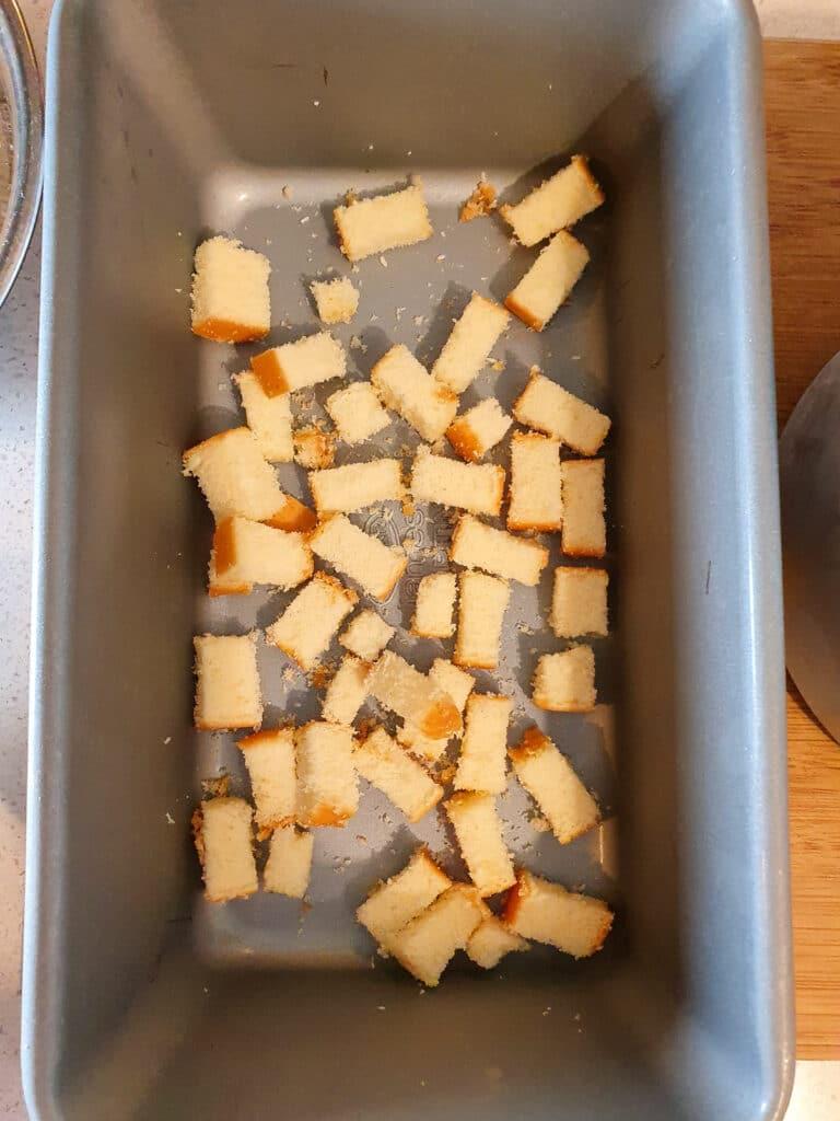 Adding first layer chopped sponge cake.
