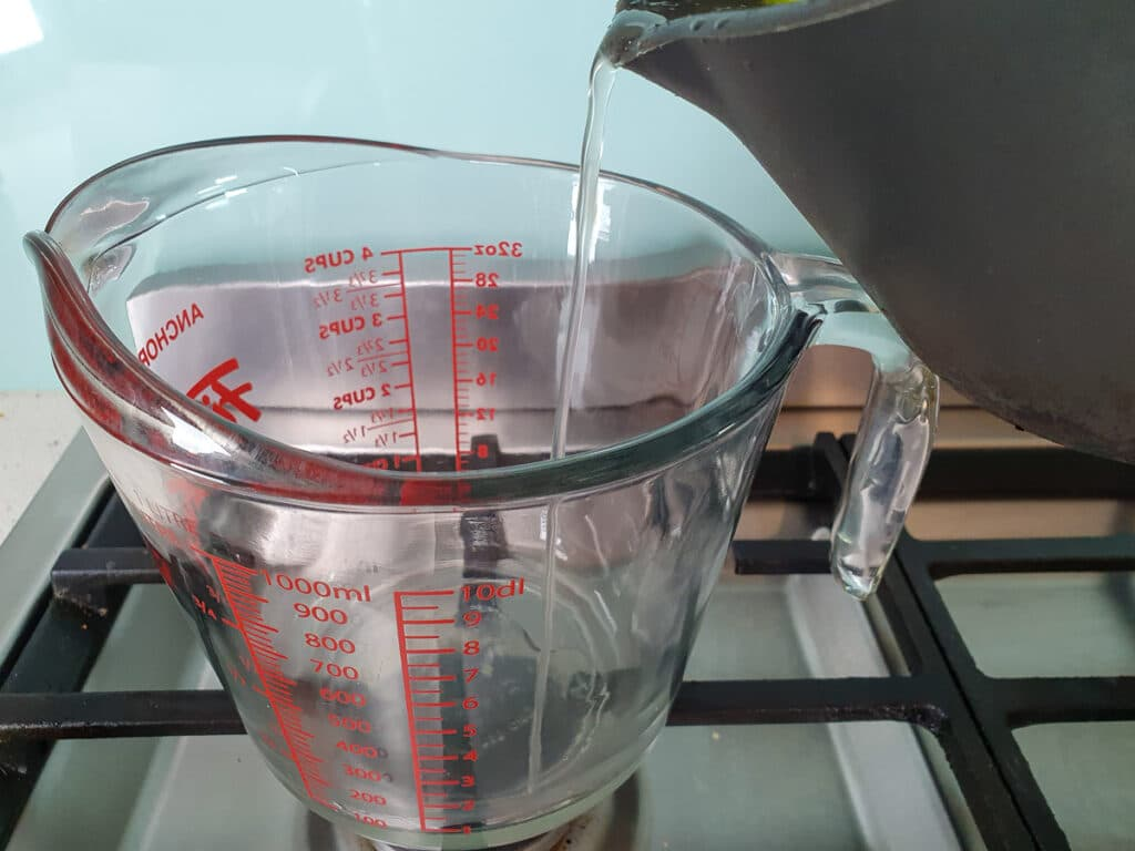 Pouring mix into heat proof container.