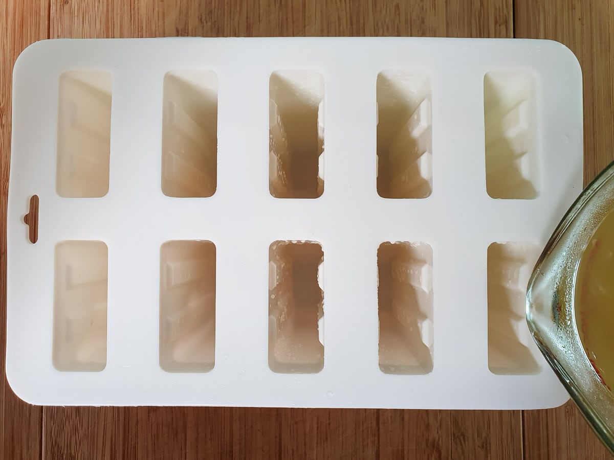 Pouring mix into popsicle molds.