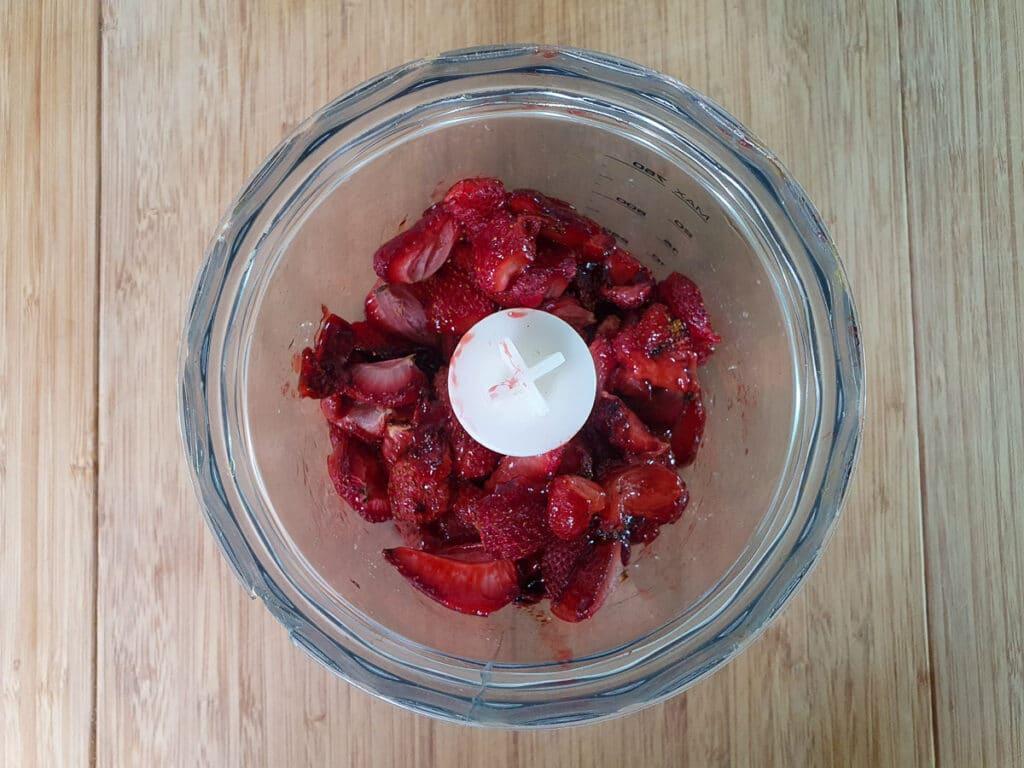 Adding strawberries to blender.