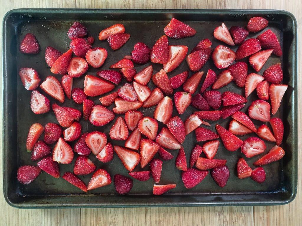 Strawberries on baking tray ready to roast.