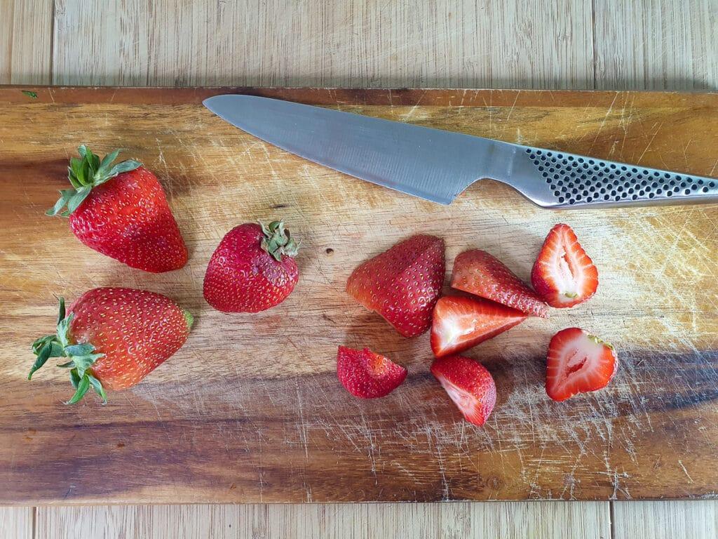 Hulling and chopping strawberries.