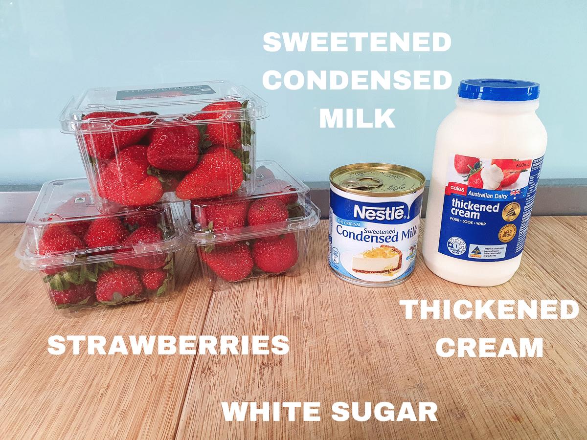 No churn strawberry ice cream ingredients, fresh strawberries, sweetened condense milk, thickened cream, white sugar (not pictured).