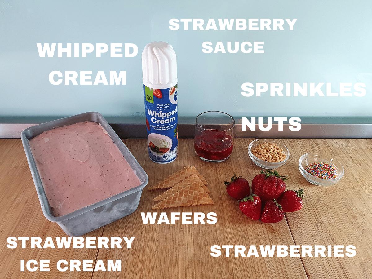 Strawberry sundae ingredients, strawberry ice cream, whipped cream, wafers, strawberry sauce, nuts, sprinkles, fresh strawberries.
