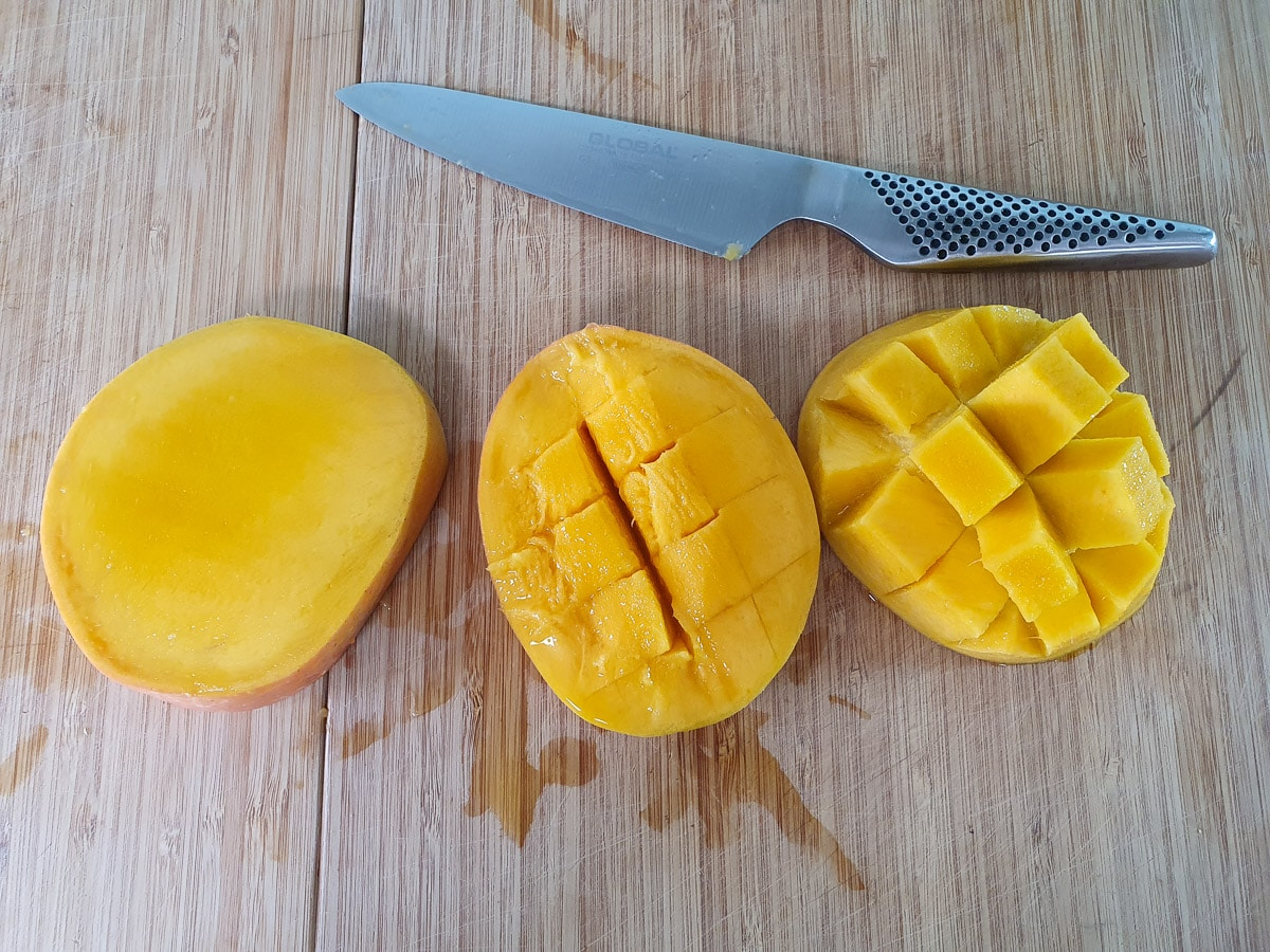 Slicing mango flesh into cubes before slicing off.