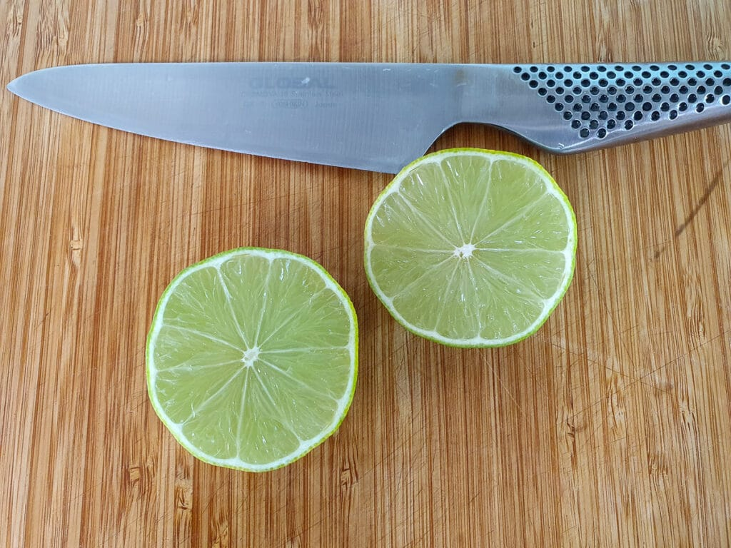 Slicing limes to juice.