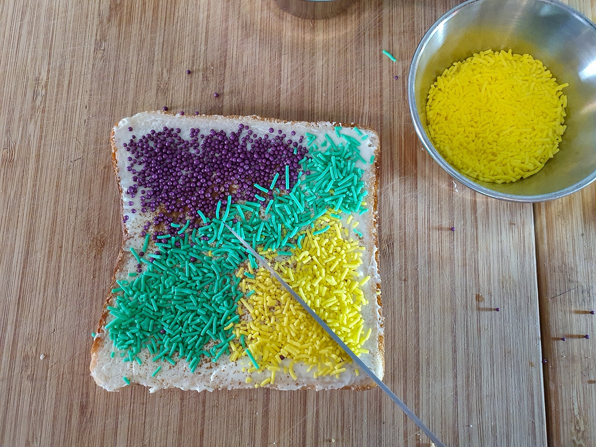 Cutting bread into triangles.