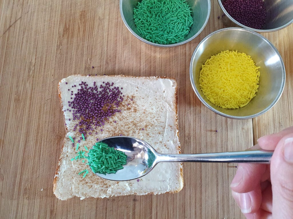Adding green sprinkles.