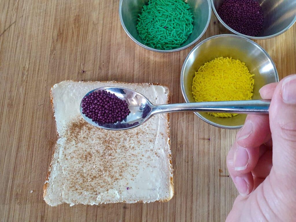 Adding purple sprinkles.
