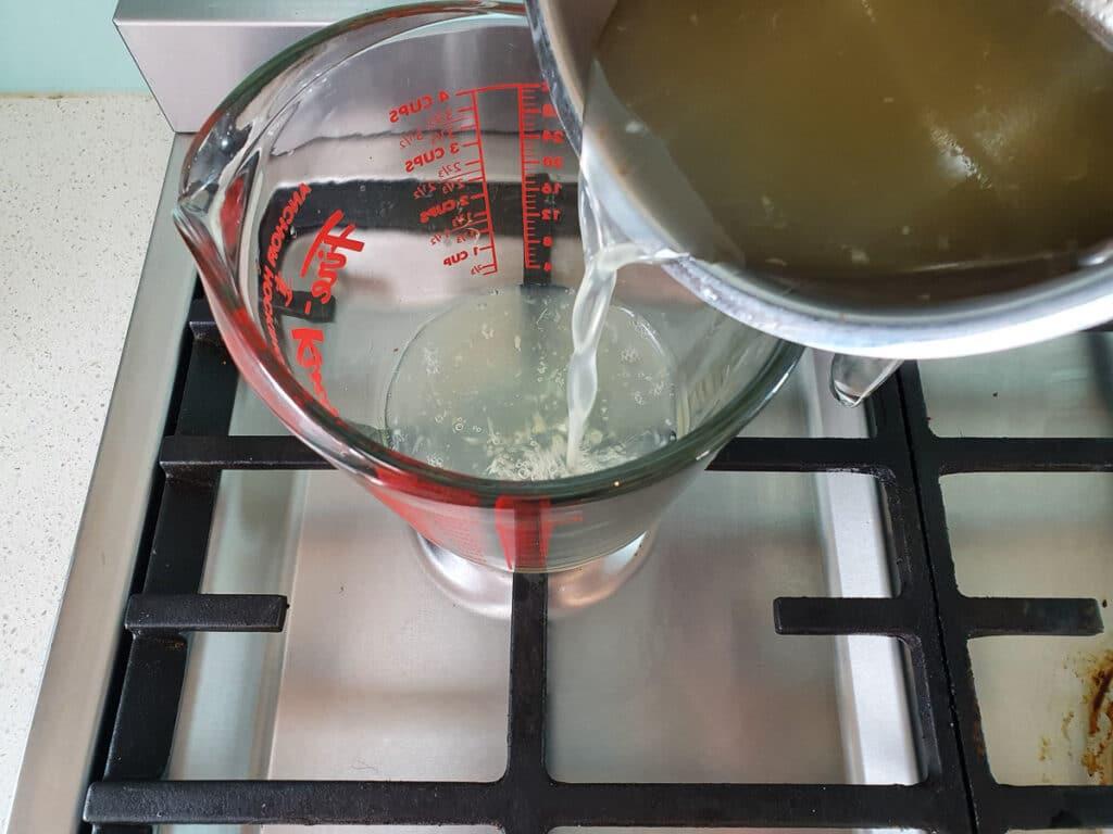 Pouring mix into a heatproof jug.