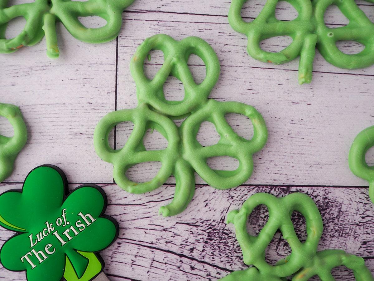 Shamrock pretzels with shamrock figurine with 'Luck of the Irish' written on it.