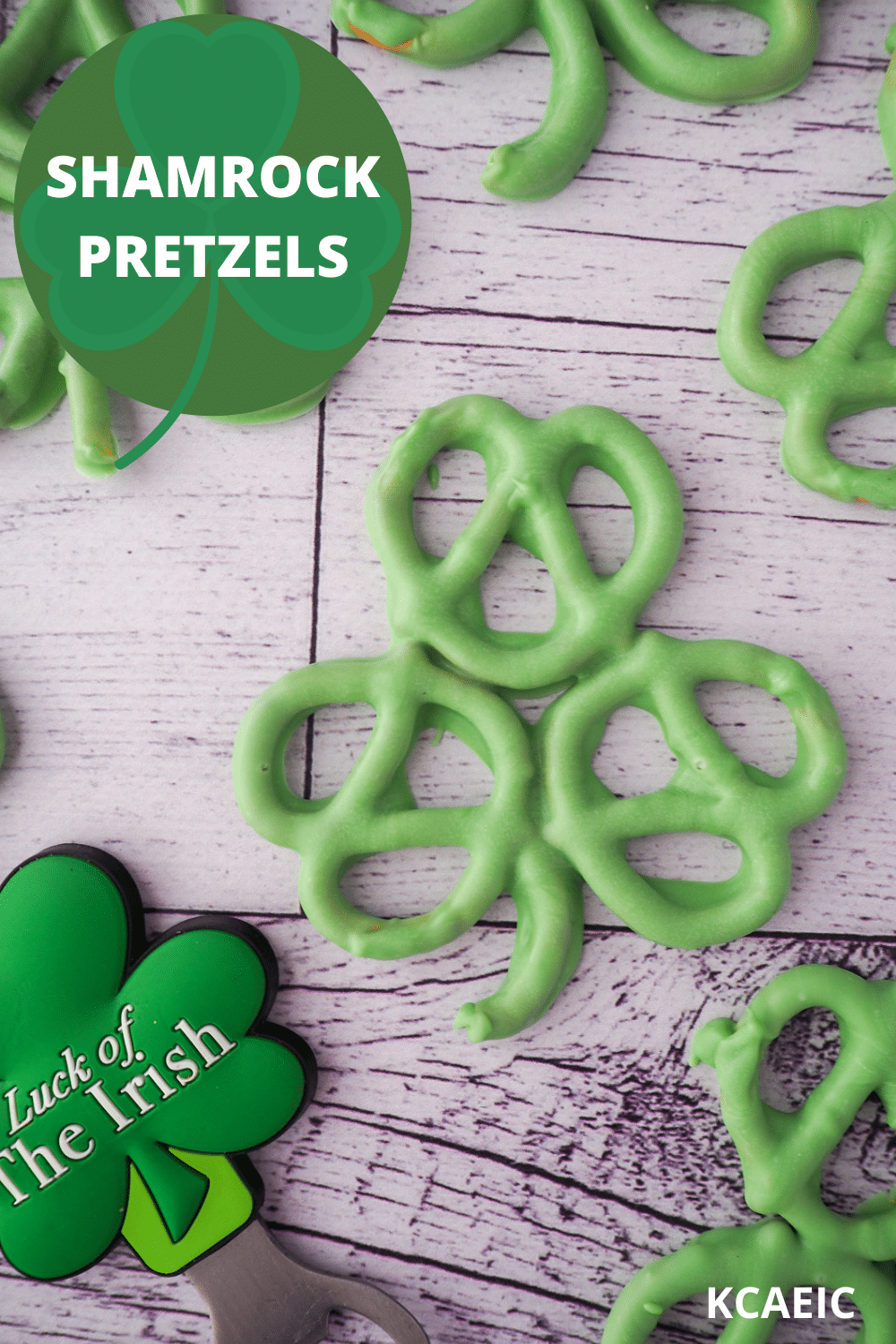 Shamrock pretzels with shamrock figurine with 'Luck of the Irish' written on it and text overlay, Shamrock pretzels and KCAEIC.