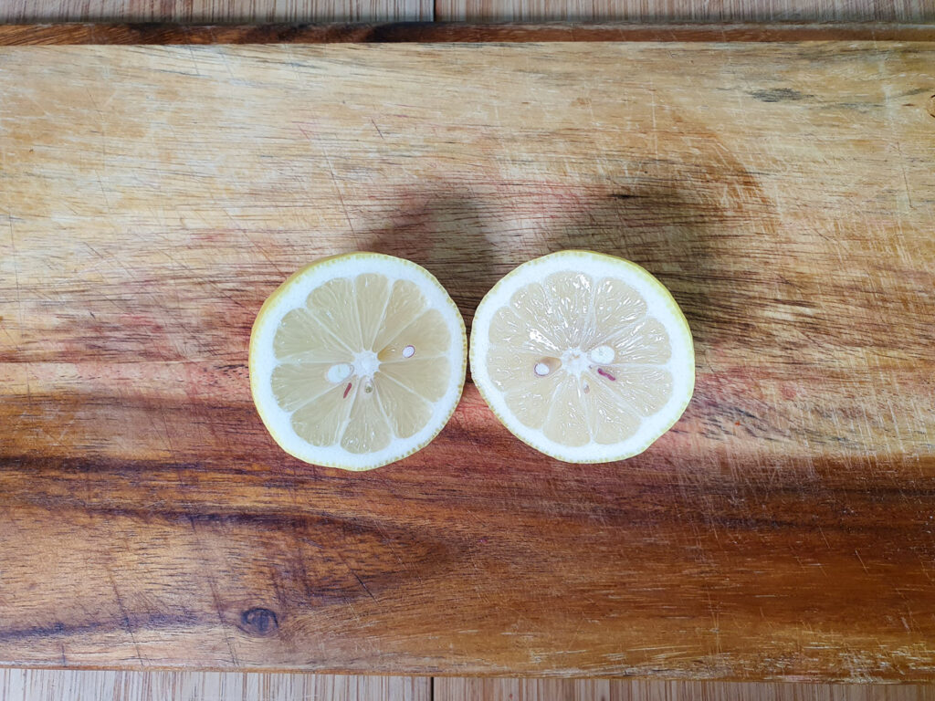 Slicing open lemon to juice.
