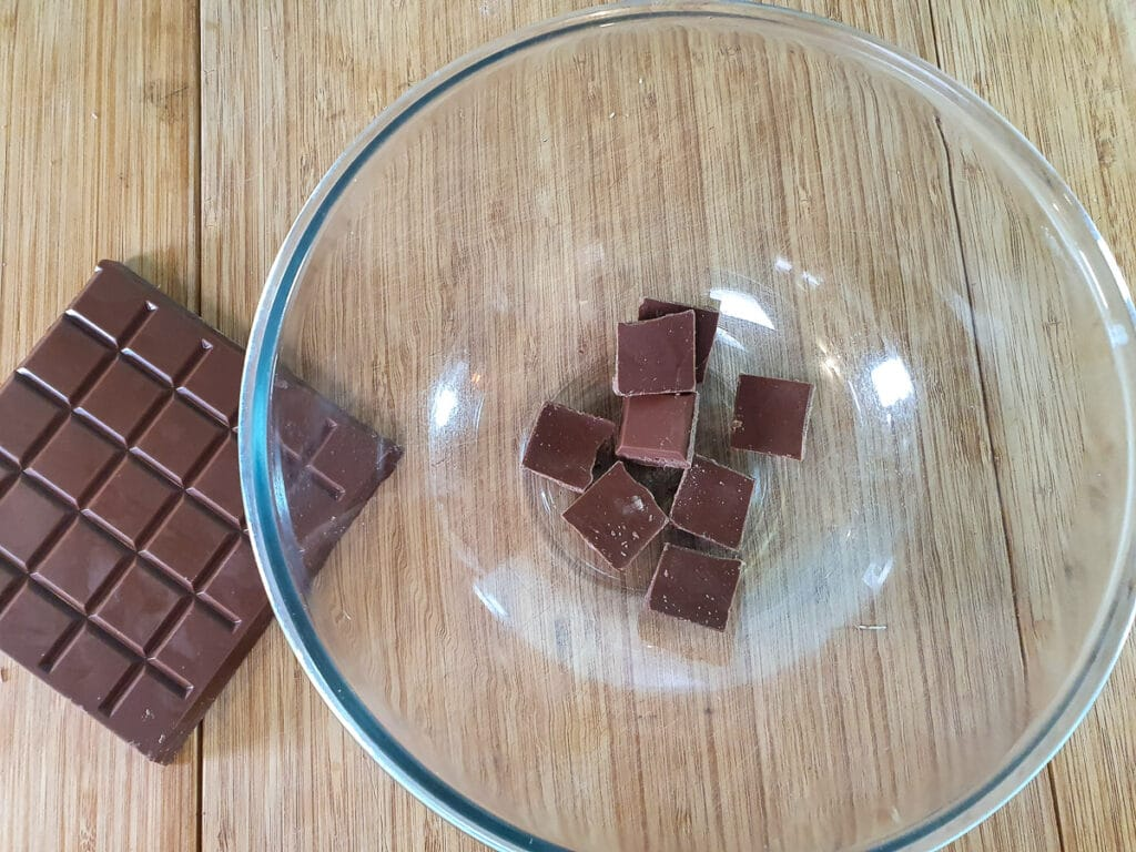 Breaking up chocolate into pieces.