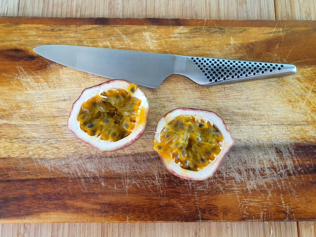 Slicing open passion fruit.
