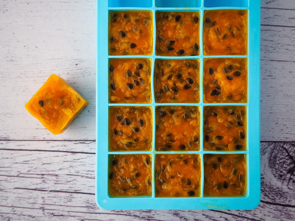 Passion fruit coulis frozen in individual serves in ice cube molds.