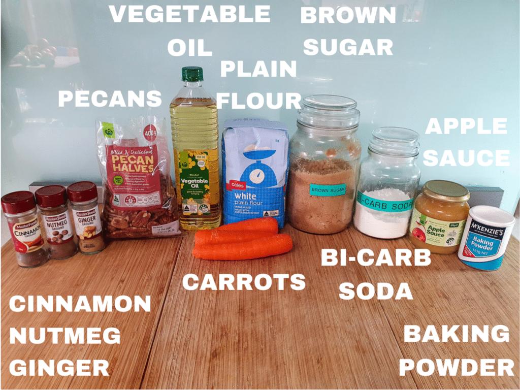 Eggless carrot cake ingredients, cinnamon, nutmeg, ginger, pecans, vegetable oil, carrots, plain flour, brown sugar, bi-carb soda, apple sauce, baking powder.