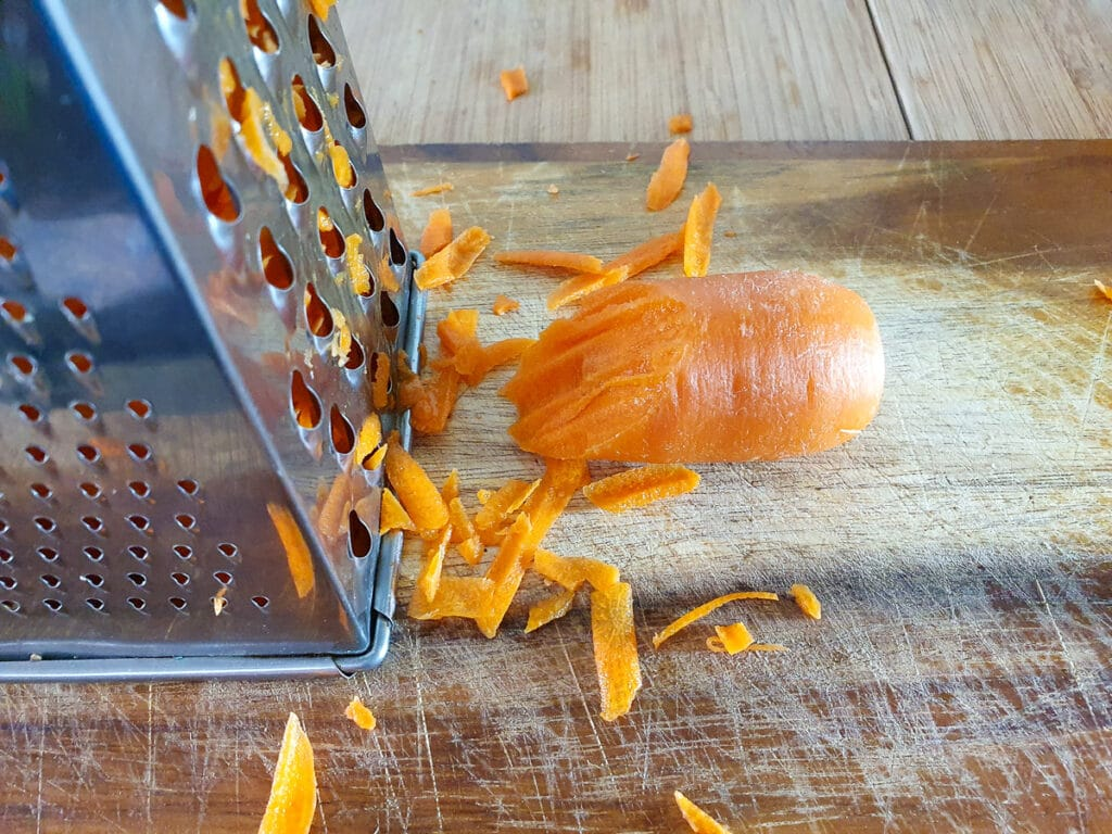 Grating carrot with the coarse side of a box grater.