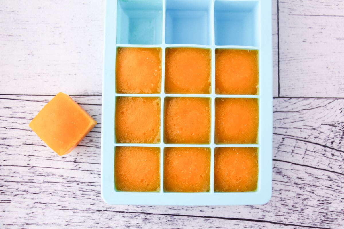 Mango coulis frozen in individual serves in ice cube molds.