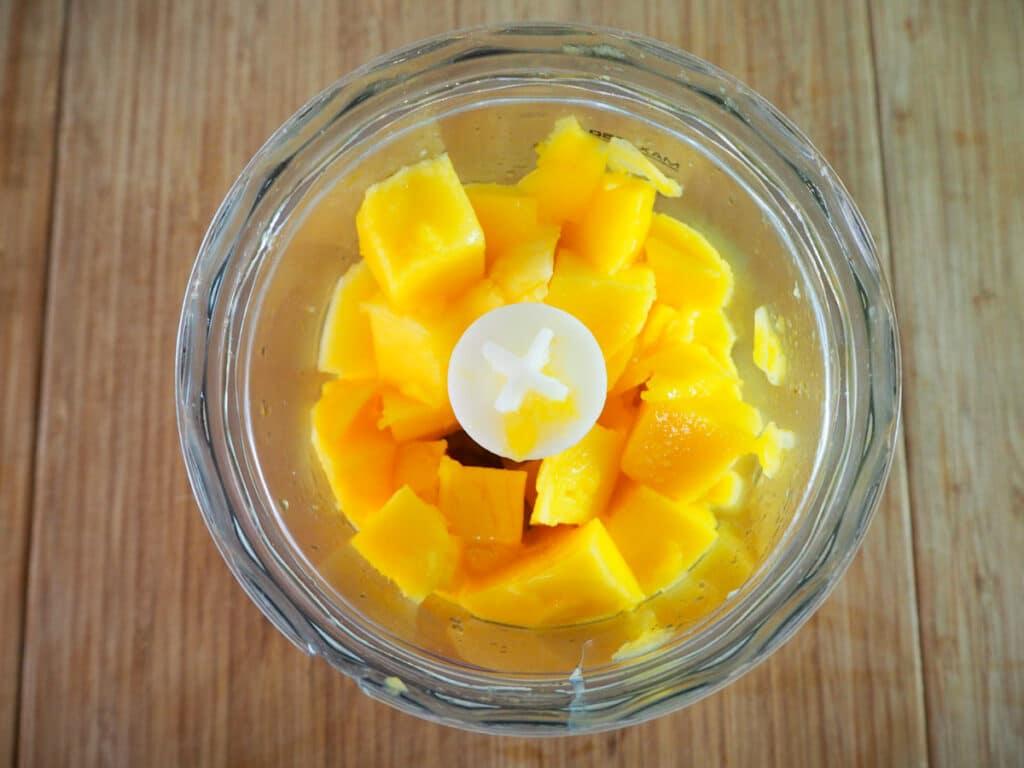 Mango flesh in food processor ready to blitz.