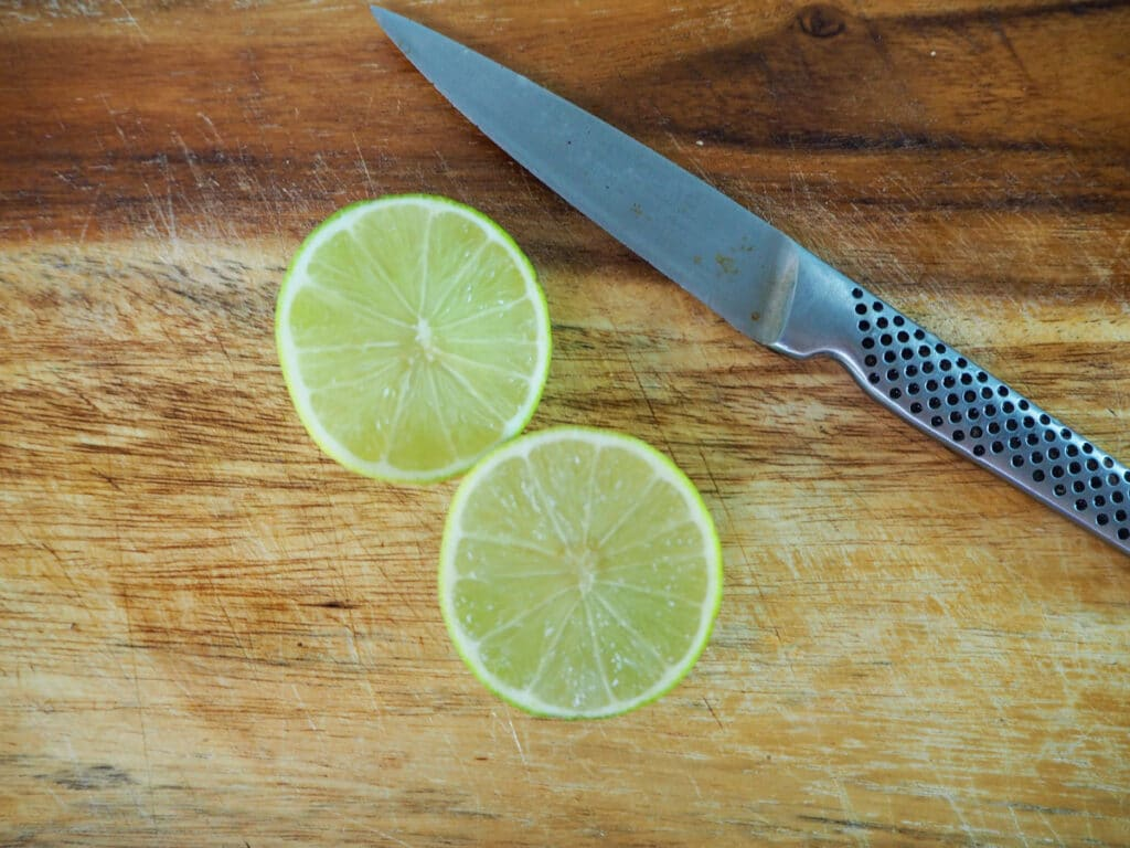 Slicing limes in half to juice.