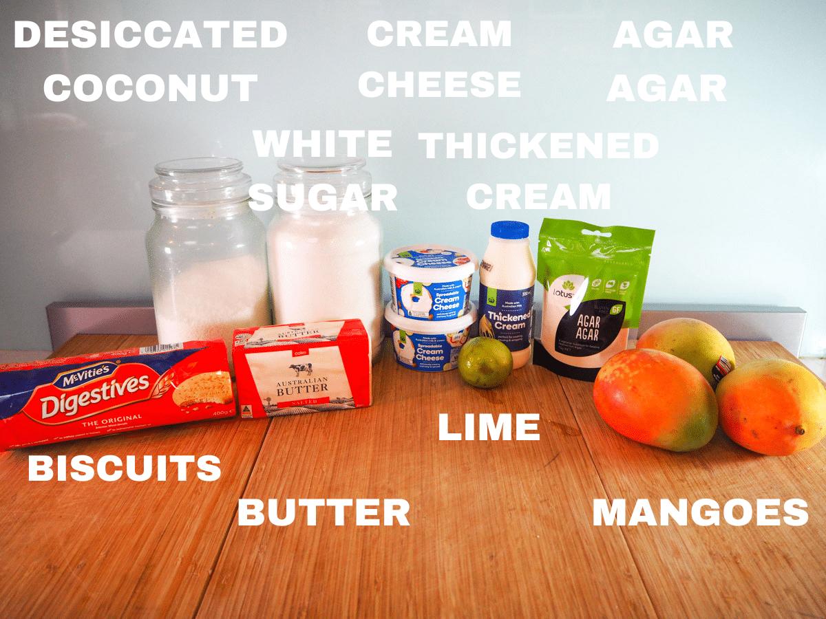 No bake mango cheesecake ingredients, desiccated coconut, digestive biscuites, white sugar, butter, cream cheese, lime, thickened cream, mangoes, agar agar powder.