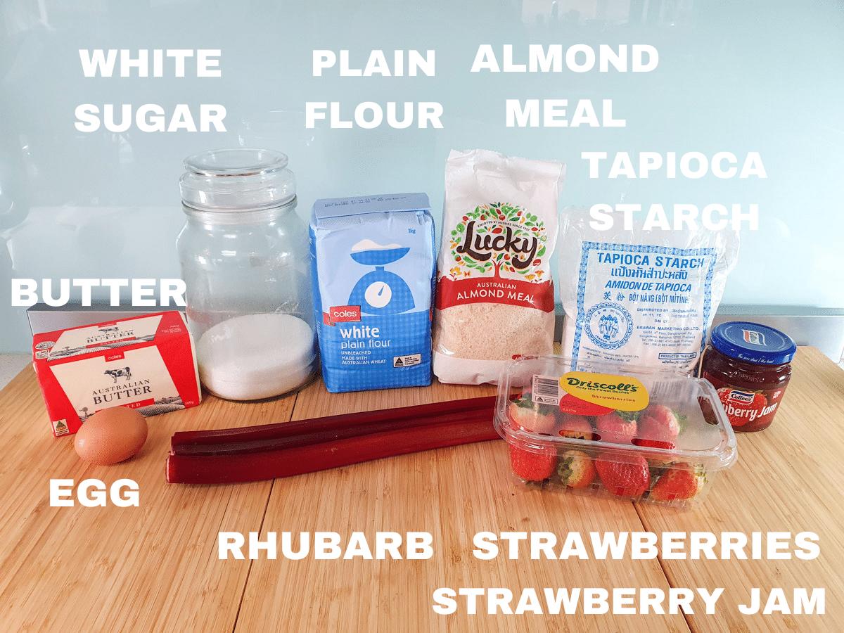 Strawberry rhubarb tartlets ingredients, salted butter, egg, white sugar, plain flour, almond meal, tapioca starch, rhubarb, strawberries, strawberry jam.