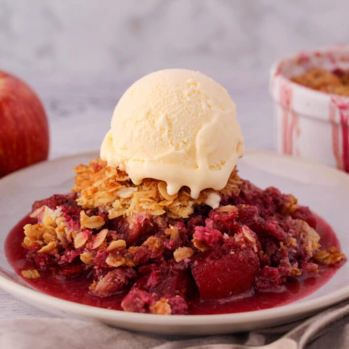 Close up apple and plum crumble with ice cream