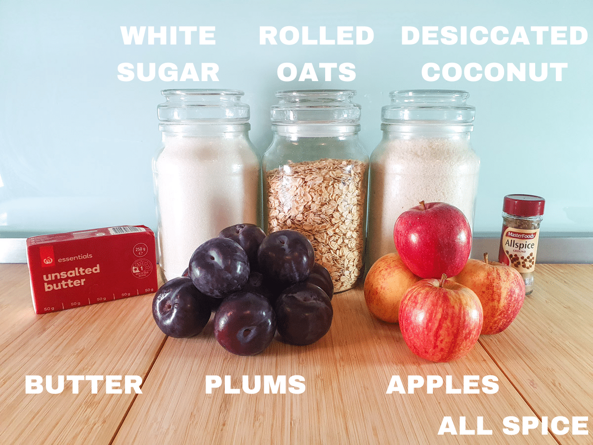 Apple and plum crumble ingredients, apples, plums, butter, white sugar, rolled oats, desiccated coconut, all spice.