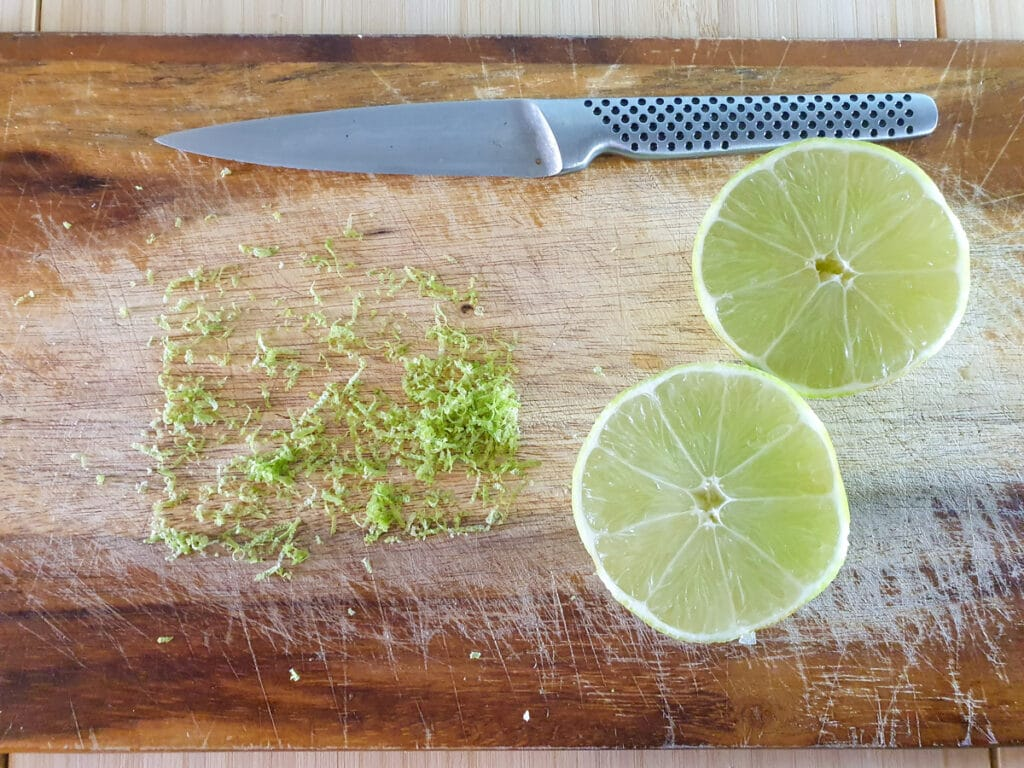 Zesting and slicing lime to juice.