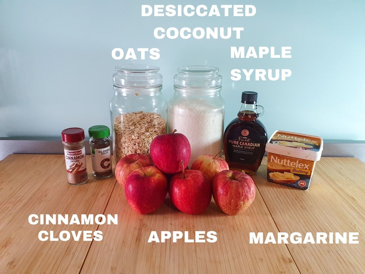 Crumble ingredients, ground cloves, ground cinnamon, rolled oats, desiccated coconut, apples, maple syrup, margarine.