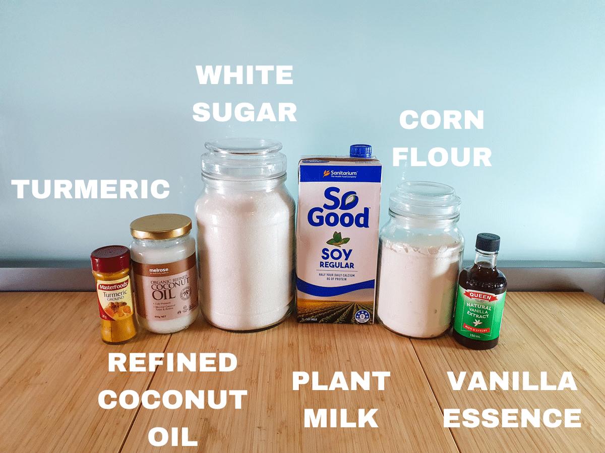 Vegan custard ingredients, turmeric, refined coconut oil, white sugar, plant milk (soy), corn flour and vanilla essence or extract.