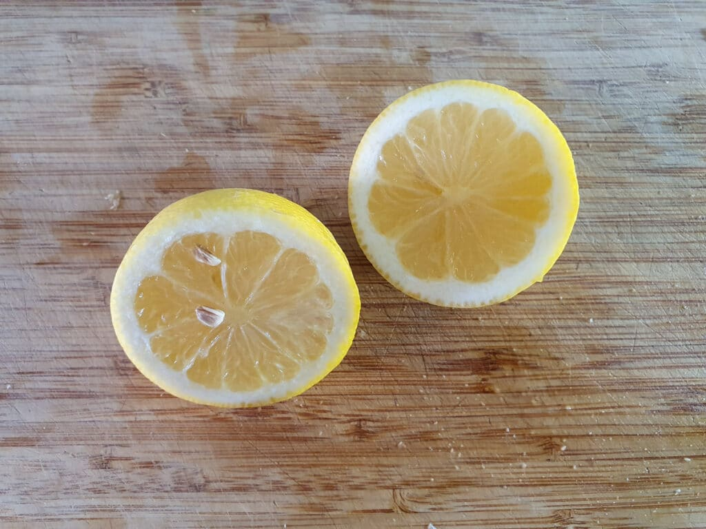 Slicing lemons to juice.