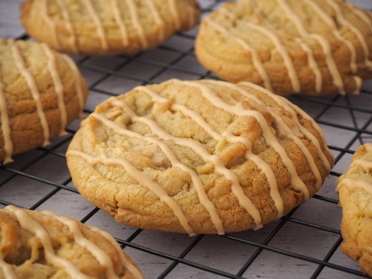 Caramilk cookies on a cooling rake.