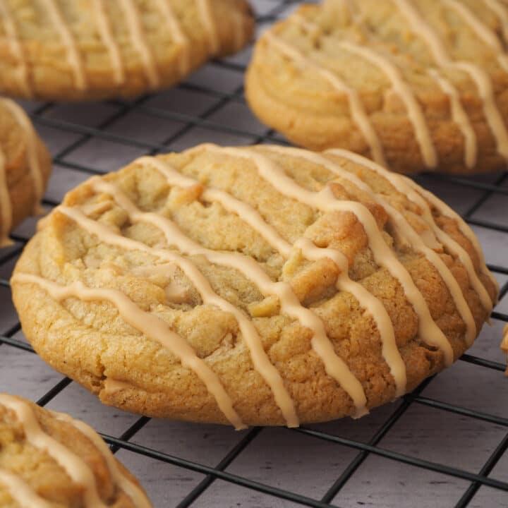 Close up caramilk cookies on a cooling rack.