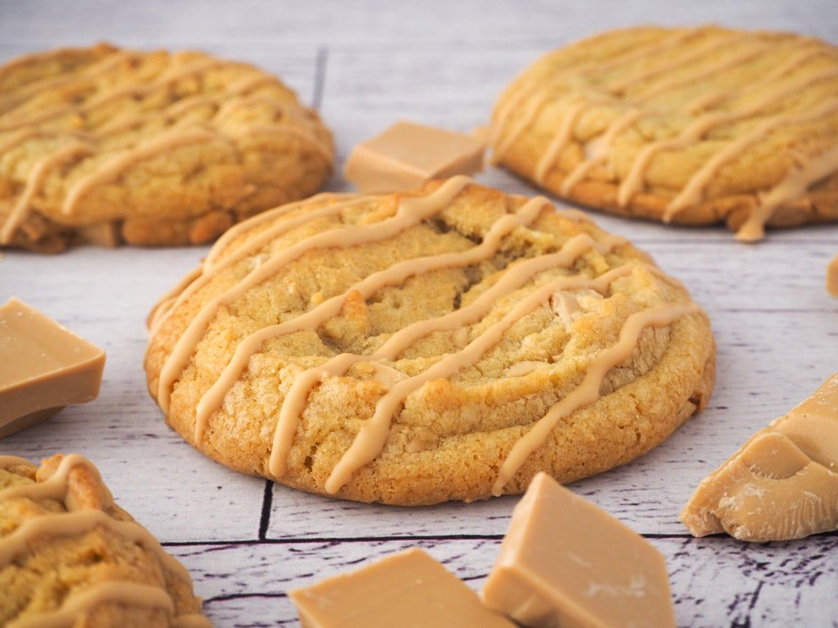 Caramilk cookies surrounded by chunks of caramilk chocolate.