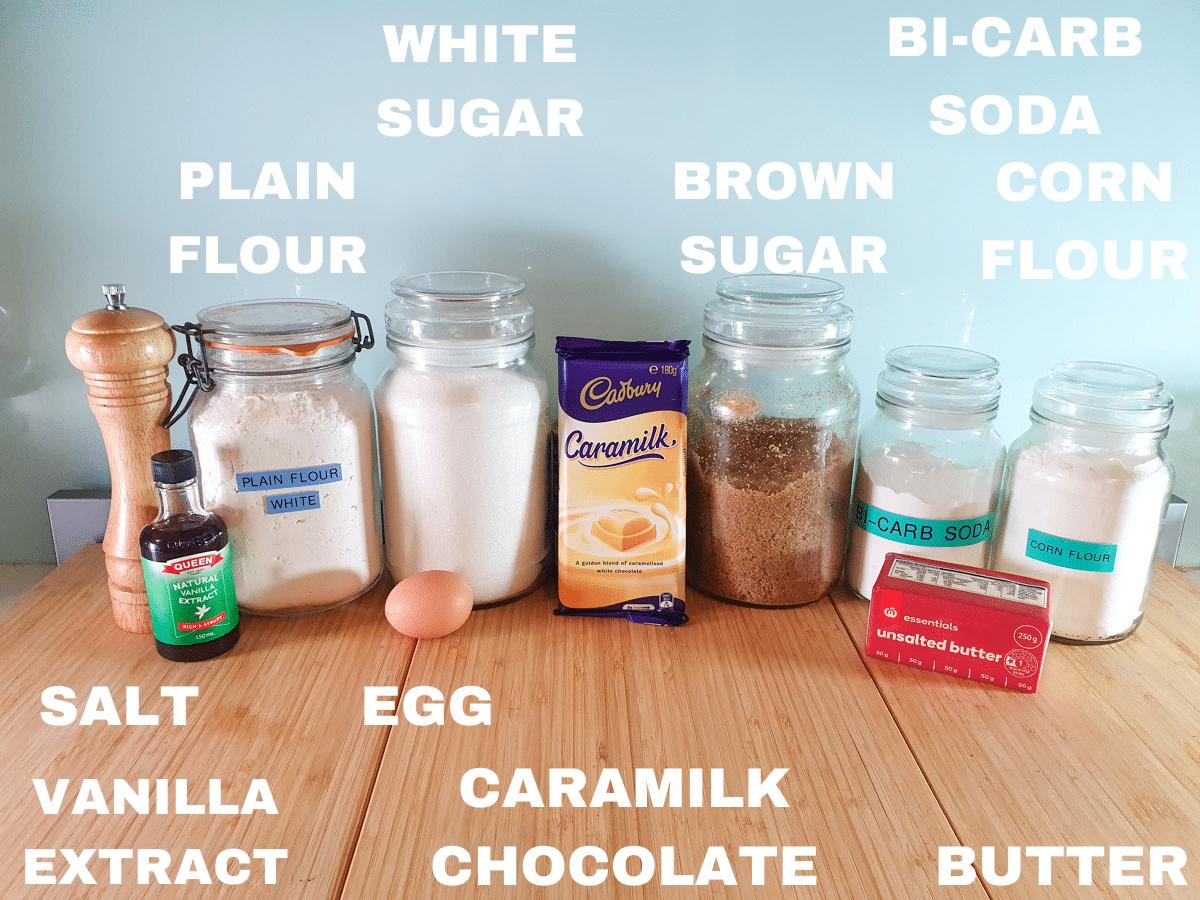 Caramilk cookies ingredients, salt, vanilla extract, plain white flour, white sugar, egg, caramilk chocolate, brown sugar, bicarb, unsalted butter, corn flour.
