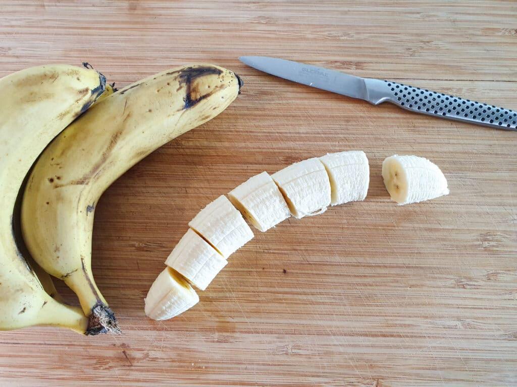 Peeling and slicing bananas into coins.