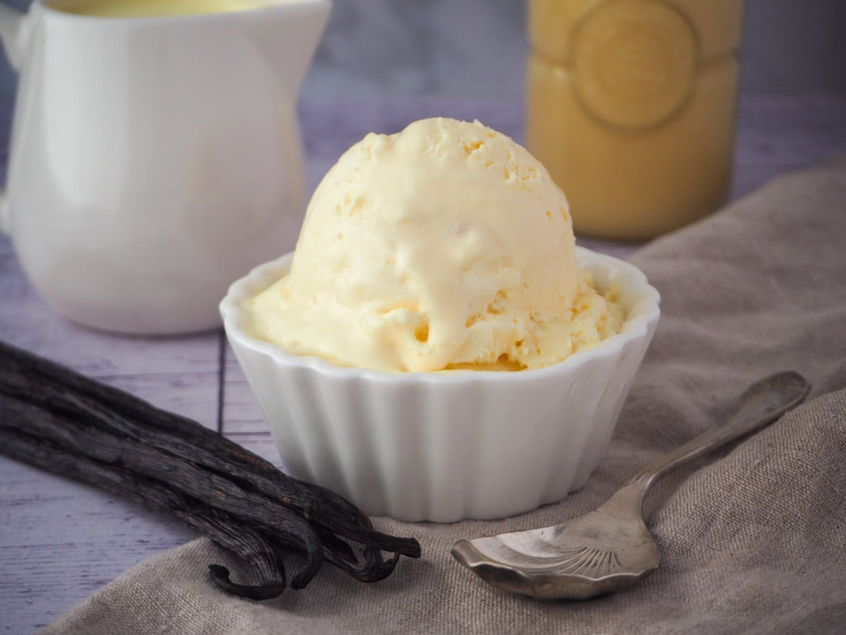 Ice cream with ingredients and spoon.