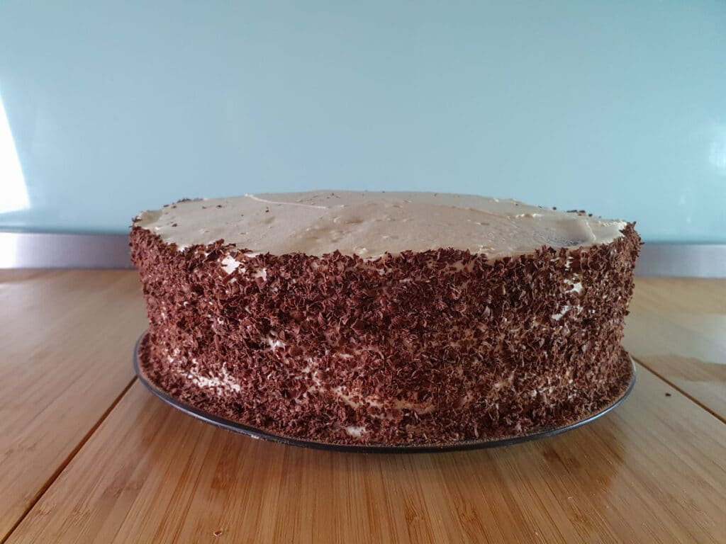 Sides of cake covered in grated chocolate.