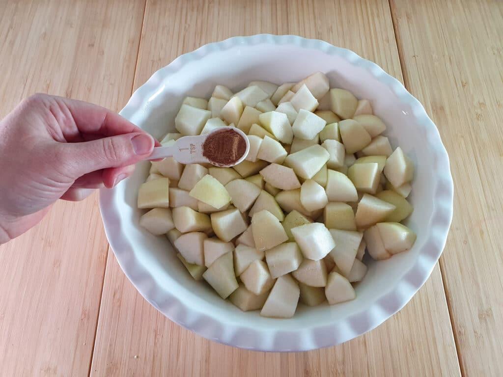 Adding cinnamon to pears.
