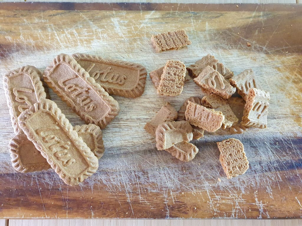Breaking up biscuits into pieces.