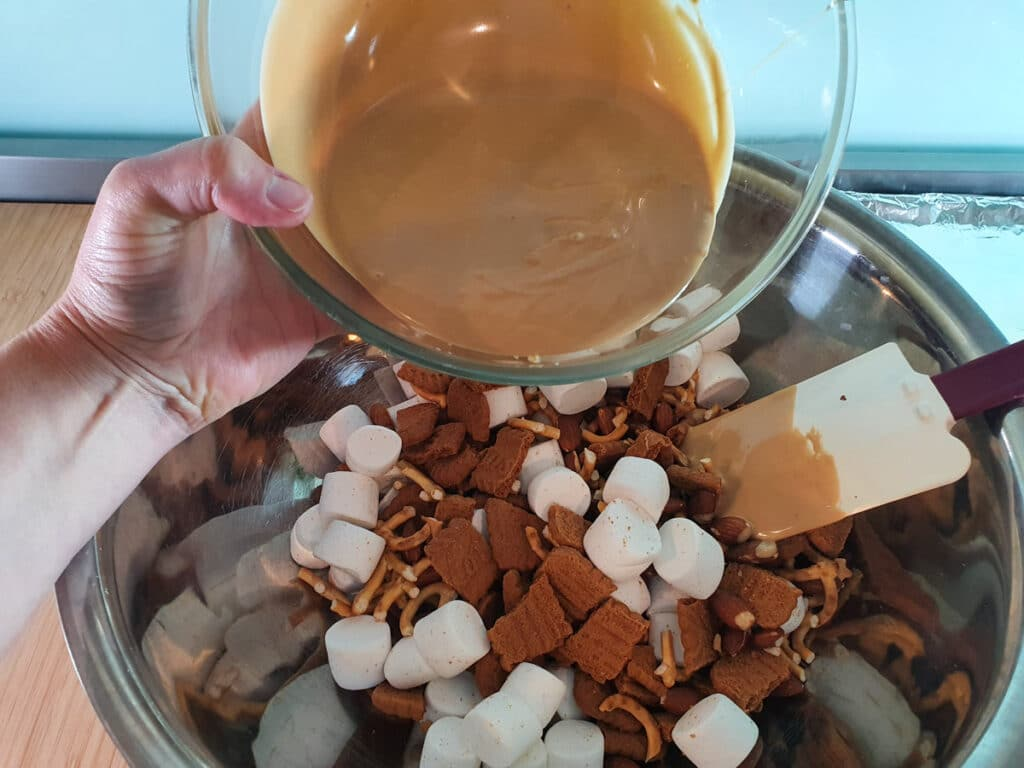 Add melted white chocolate and biscoff spread to dry ingredients.
