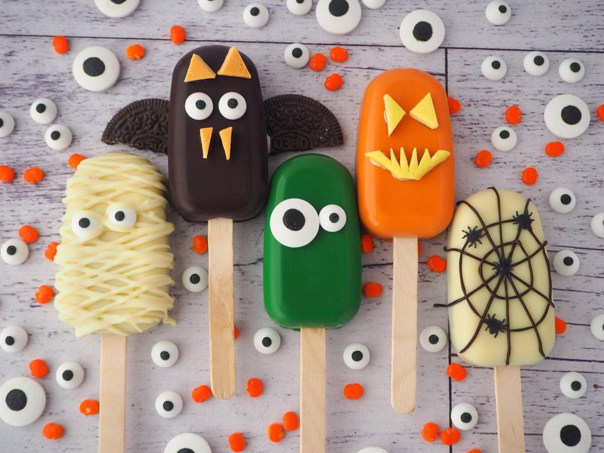 Mummy, bat, monster, jack-o-lantern and spider cakesicles.