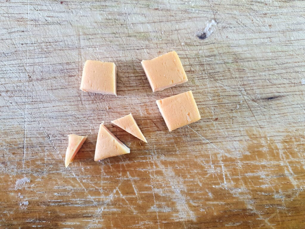 Showing small square that's been cut into one larger triangle, with two smaller, pointer triangles to the sides.