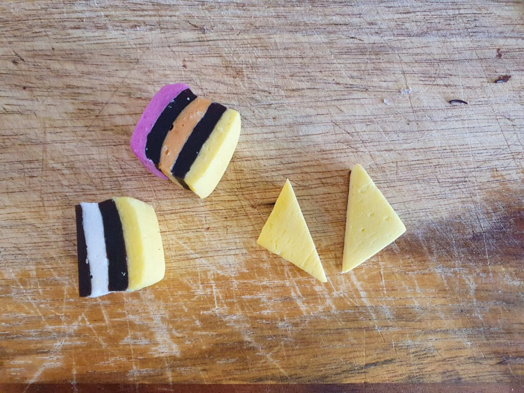 Cutting thin candy square in half.